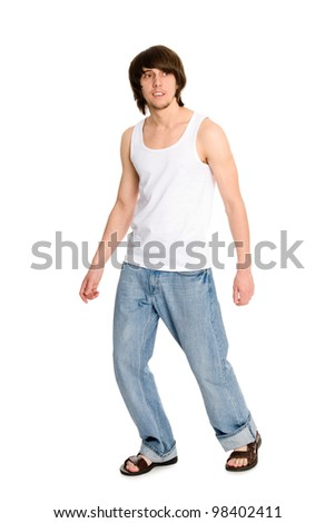 Portrait of a young man walking - stock photo