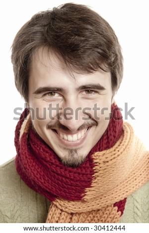 Portrait of a young man wearing a scarf and green pullover - stock photo
