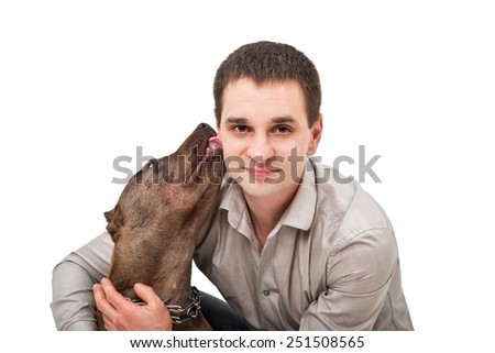 Portrait of a young man who licks pitbull close up isolated on white background - stock photo