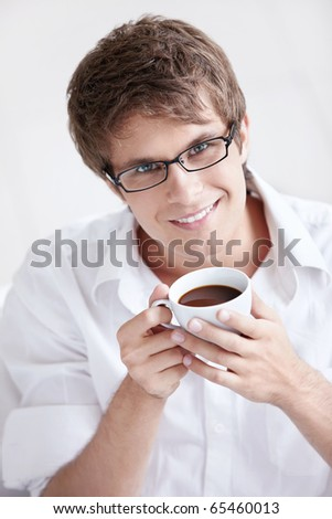 Portrait of a young man with a cup of coffee - stock photo