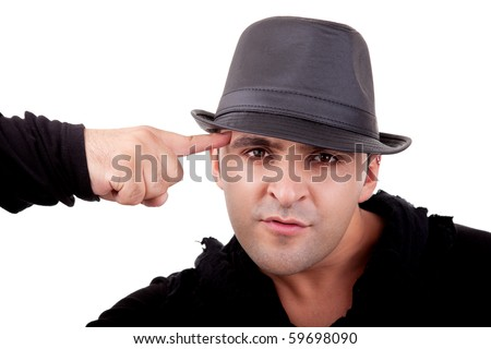 Portrait of a young man, with a finger pointing to the head, isolated on white. Studio shot - stock photo