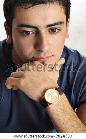 Portrait of a young man with an attitude - stock photo