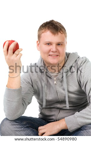 portrait of a young man with apple, isolated on white - stock photo