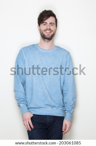 Portrait of a young man with beard smiling on white background