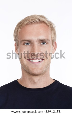 portrait of a young man with blond hair and blue eyes - isolated on white - stock photo
