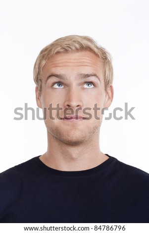 portrait of a young man with blond hair looking up - isolated on white - stock photo