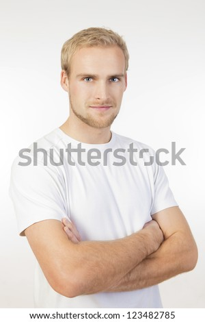 portrait of a young man with blond hair standing- isolated on white
