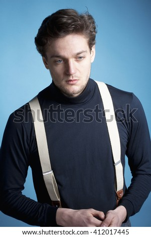 Portrait of a Young Man with Brown Hair with Suspenders. - stock photo