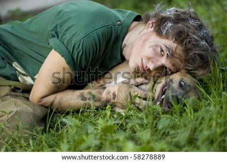 Portrait of a young man with his best friend - dog - stock photo