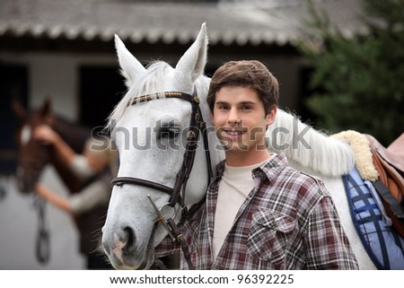 portrait of a young man with horse