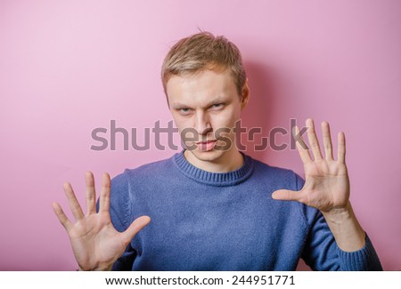 Portrait of a young man with sign alt as a concept to stop in business - stock photo
