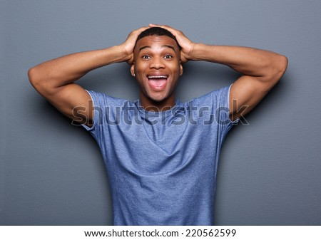 Portrait of a young man with surprised expression on face - stock photo