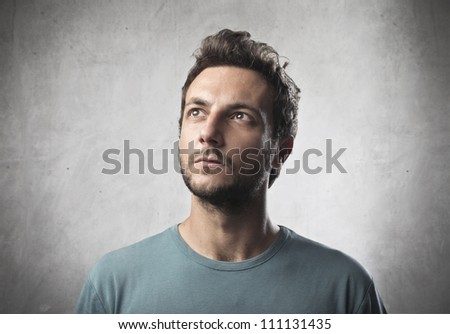 Portrait of a young man with thoughtful expression - stock photo
