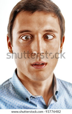 Portrait of a young man with troubled eyes. Isolated on white