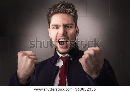 Portrait of a young man yelling, screaming, shouting, power, strength