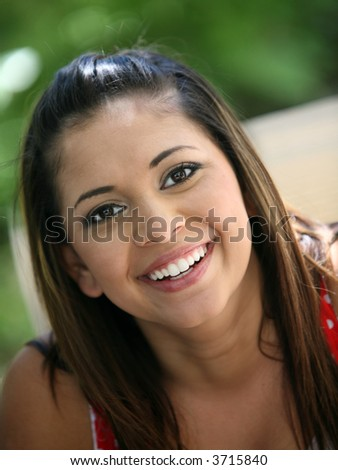 Portrait of a young mexican girl laughing - stock photo