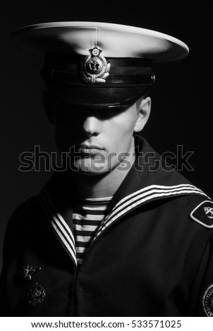 Portrait  of a young model in navy uniform
