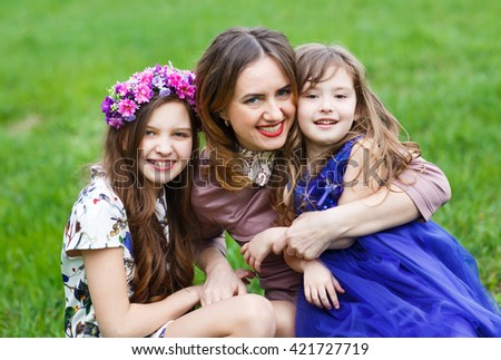 Portrait of a Young mother and her two daughters. - stock photo