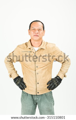 Portrait of a young motorcyclist posing isolated on white background.