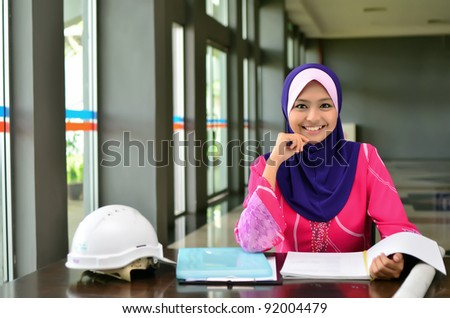 Portrait of a young Muslim architect-woman smile