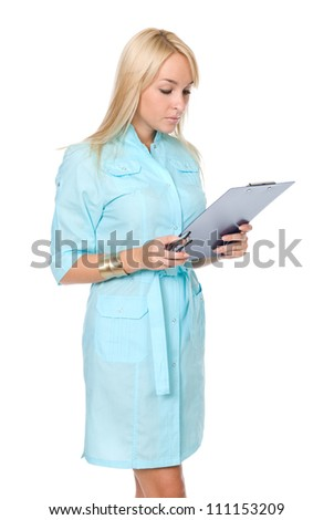 Portrait of a young nurse with file folders over white background - stock photo