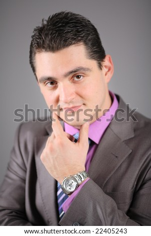 Portrait of a young person in a suit - stock photo