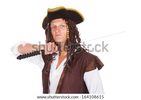 Portrait Of A Young Pirate Holding Sword On White Background
