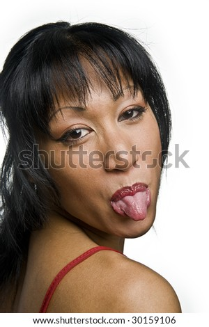 portrait of a young pretty asian woman stick her tongue out - stock photo
