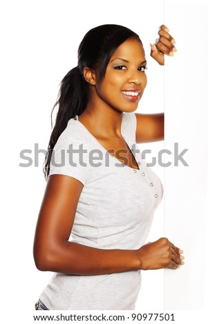 Portrait of a young pretty black woman holding a white signboard.