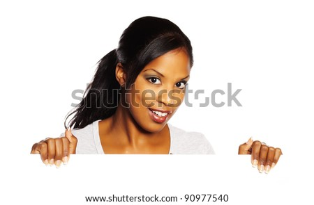 Portrait of a young pretty black woman holding a white signboard. - stock photo