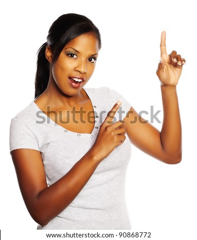 Portrait of a young pretty black woman pointing with the fingers. - stock photo