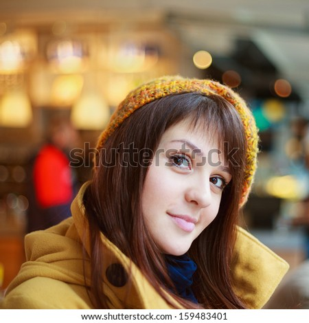 Portrait of a young pretty brunette woman in autumn outfit - stock photo