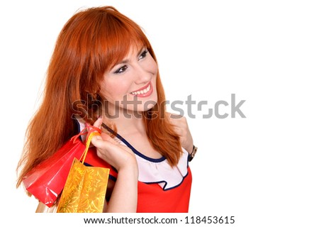 portrait of a young pretty girl with shopping bags on white background