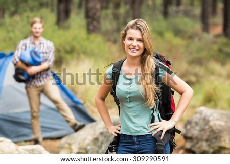 Portrait of a young pretty hiker with hands on hips in the nature - stock photo