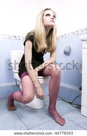 Portrait of a young prostitute in bath - stock photo