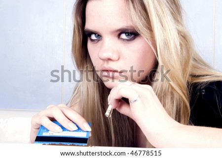 Portrait of a young prostitute snuff in bath - stock photo