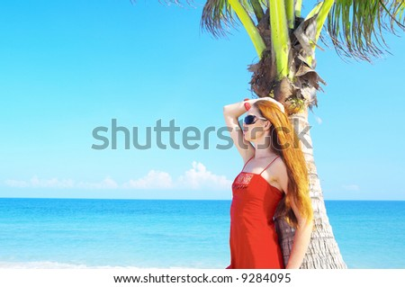 portrait of a young red-hair  female in summer environment