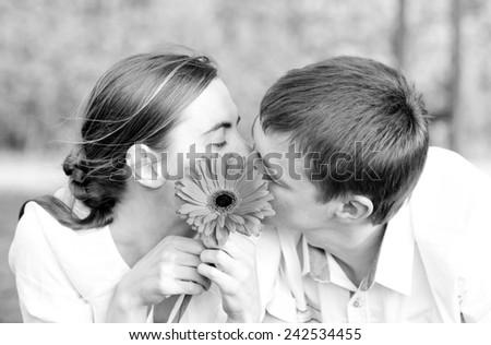 Portrait of a young romantic couple - stock photo