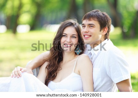 Portrait of a young romantic couple embracing each other - stock photo