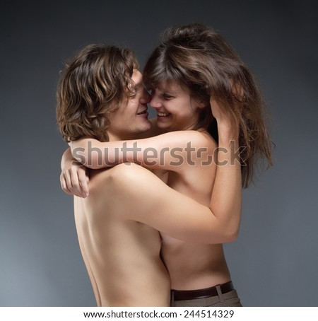 Portrait of a Young Romantic Couple Embracing, Smiling - stock photo