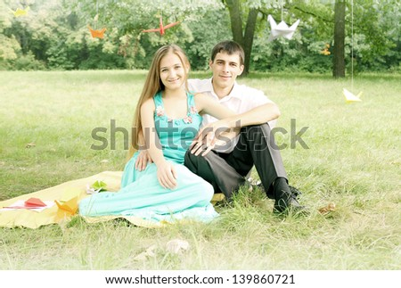 Portrait of a young romantic couple on nature - stock photo