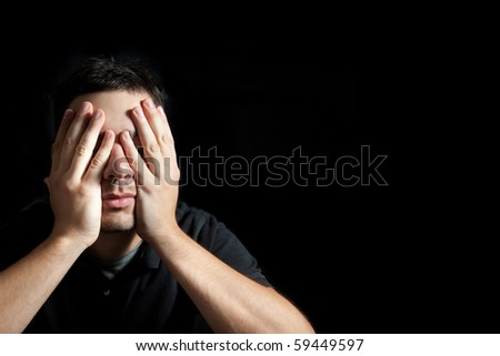 Portrait of a young sad man - stock photo