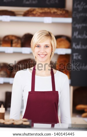 portrait of a young saleswoman working in bakery