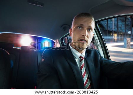 Portrait Of A Young Scared Man Pulled Over By Police - stock photo