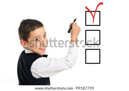 portrait of a young school boy wrighting or drawing checkboxes with black point pen isolated on white background