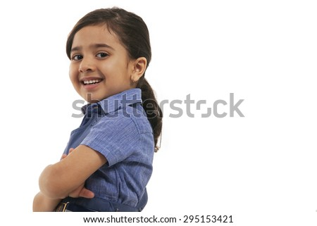 Portrait of a young school girl smiling - stock photo