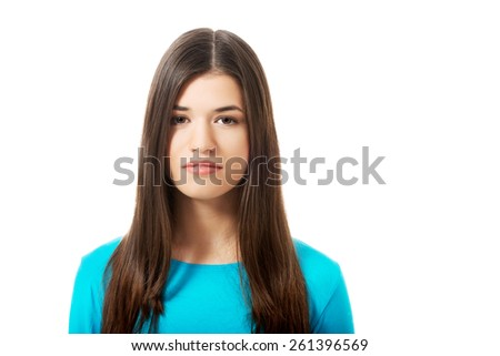 Portrait of a young serious woman. - stock photo