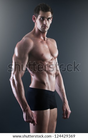 Portrait of a young sexy shirtless muscular man in underwear - stock photo