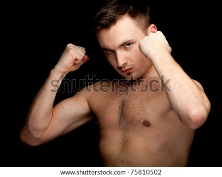 portrait of a young shirtless man ready to fight