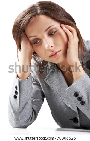 Portrait of a young sleepy businesswoman - stock photo
